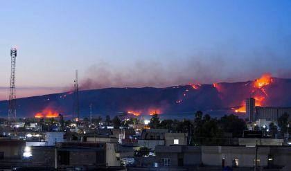 حريق يلتهم عشرات الدوانم من الحنطة غرب الموصل واصابة منتسب بالدفاع المدني