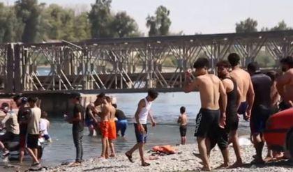 نينوى.. مواطنون يقاومون حرارة الصيف الحارقة بالسباحة في نهر دجلة