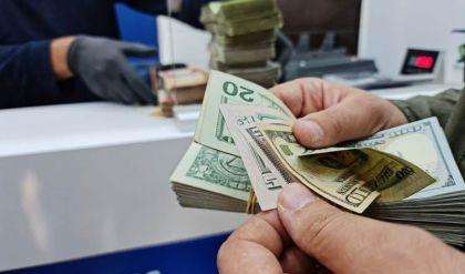 سعر الدولار يرتفع لأكثر من 1457 ديناراً