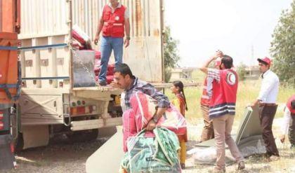 الهلال الاحمر التركي يوزع مساعدات لنازحي أيمن الموصل