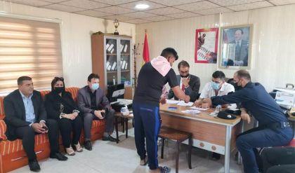 الهجرة العراقية تعلن توزيع المنحة الطارئة لمتضرري مخيم شاريا